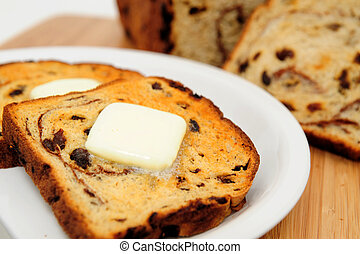 Raisin Cinnamon Toast - Raisin bread toast with melting...