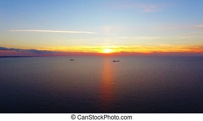 Two Boats Floating In The Sea At Sunset - AERIAL VIEW. This...