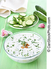Spring soup with yoghurt, cucumbers, dill and walnut