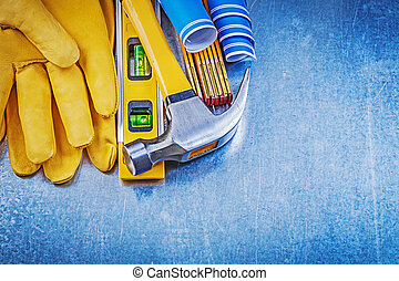 Safety gloves claw hammer blue construction drawings level...