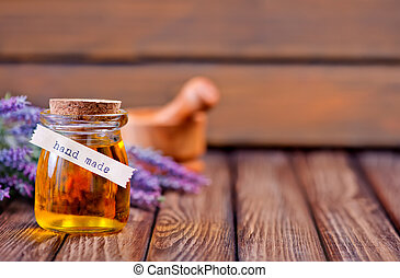 lavender oil in bottle and on a table