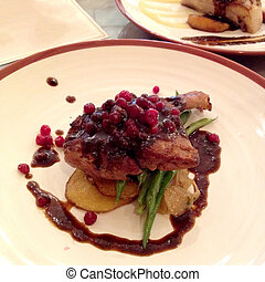 Duck confit, served with french beans, roasted potato and...