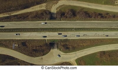 Traffic Moving On Motorway - AERIAL VIEW The shot captured...