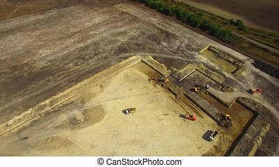 Construction Machinery Working On Field - AERIAL VIEW. Brown...