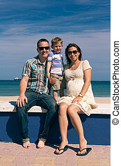 Happy family enjoying sunny day on the coast in Spain -...