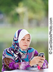 Women playing her mobile phone