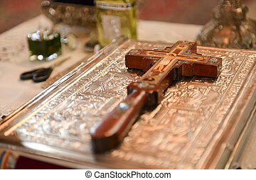 Cross placed on the Bible in a church