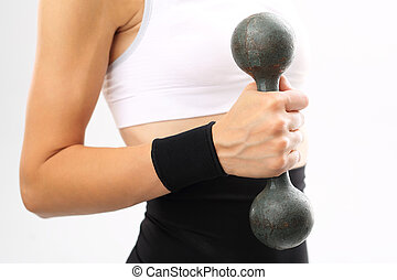 band stabilizing the wrist - Woman with a dumbbell a band...