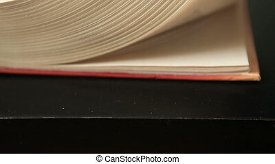 quickly leaf through the book, close-up