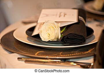 Menu and plates - A fancy dinning menu on a dinning set