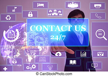 CONTACT US concept  presented by  businessman touching on  virtual  screen ,image element furnished by NASA