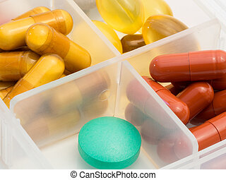 Drugs - A container for pills with different medicines.