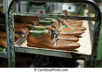 Classic mens elegance shoes - Bookcase in the workshop of...