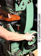 Workshop, shoemakers workshop - Shoes shoemaker sews on the...