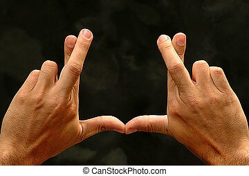 hands with crossed fingers
