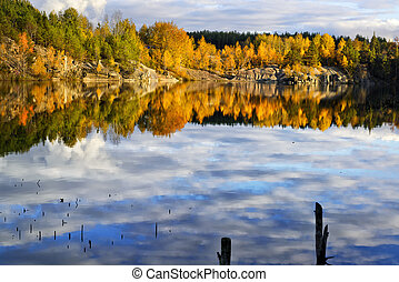 Beautiful lake - Fall time on a beautiful lake with rocky...