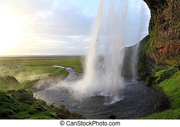 Seljalandsfoss, Iceland - walking behind the amazing...