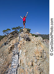 Hiker stands on top of the mountain