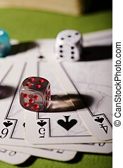 Transparent dice on playing cards - Vertical photo of used...