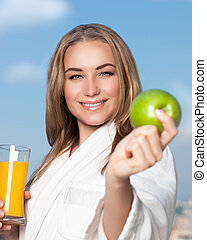 Healthy eating woman - Portrait of beautiful smiling woman...