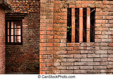 Scary old ruin with red brick wall