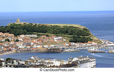 Scarborough harbor and castle headland, North Yorkshire,...