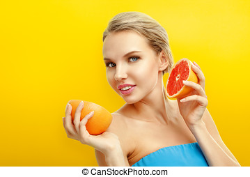 Young woman with fruits on bright orange background - Young...