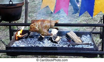 Roasted chicken on a spit, 4K UHD video