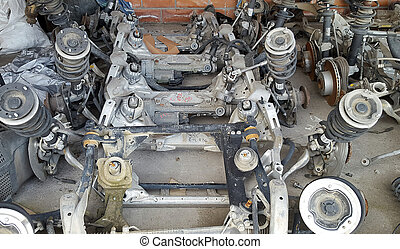 Stack of old axle - Stack of used axle and other parts for...