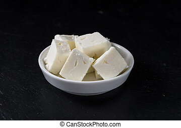 Feta Cheese on a slate slab - Portion of creamy Feta Cheese...