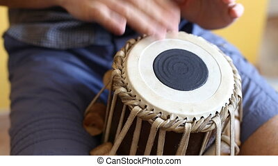 Playing Bongo drum close up HD stock footage. Hand tapping a...