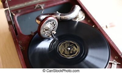 Loop-able Vintage Video of Old Gramophone, playing record,...