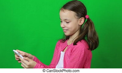 Technology and internet concept - little student girl with...