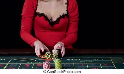 Girl gambles at the casino club. Black. Cam moves top down