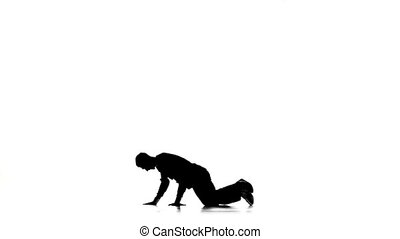 Young dancer man dancing breakdance professional moves, white, silhouette, slow motion