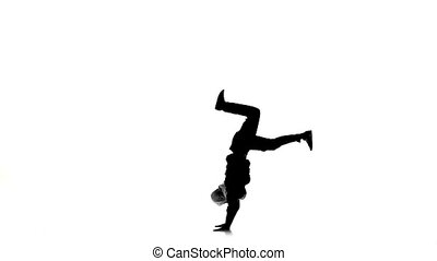 Young man dancing breakdance on hands, white, silhouette,...