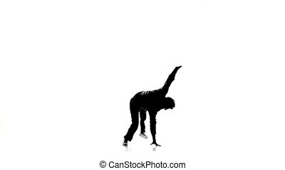 Dancer man dancing breakdance professionally moves, white, silhouette, slow motion