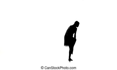 Young woman dancer continue dancing contemporary dance on white, silhouette, slow motion