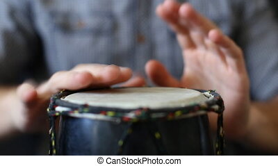 Playing Bongo drum close up HD stock footage Hand tapping a...