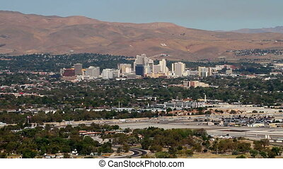 Reno Nevada Skyline - Traffic moves along Interstate 580 in...
