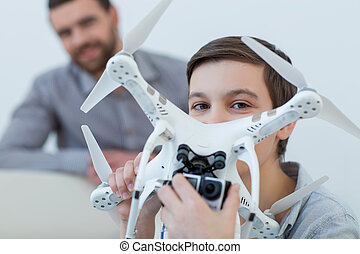 Pretty friendly family is playing with a drone - Look at...