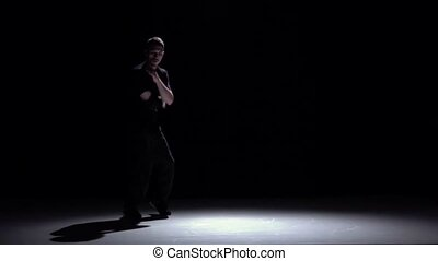Modern breakdance man jumping on hands dancing, black, shadow, slow motion