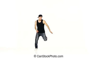 Modern style dancer in black suit dancing breakdance on...
