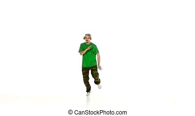 Dancer in green shirt dancing breakdance, makes movement,...