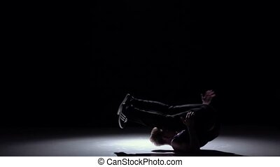 Blonde dancer starts dancing breakdance on his hands, black,...