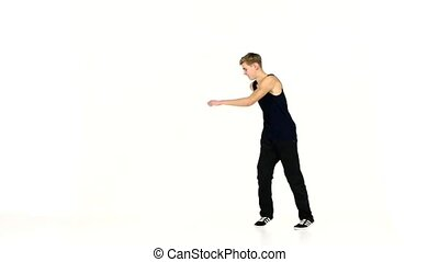 Modern style dancer in black suit continue dancing...