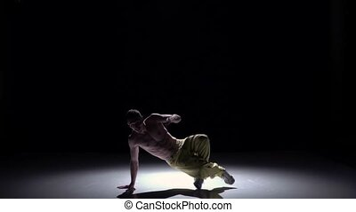 Breakdance dancer man in yellow trousers with torso starts...