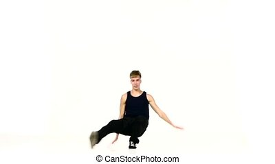 Stylish man go on dancing breakdance on white, slow motion -...