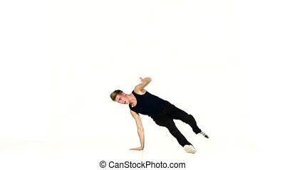 Young man in black suit go on dancing breakdance, white,...