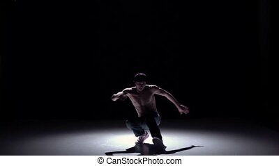 Breakdance man dancing from sitting position breakdance on...